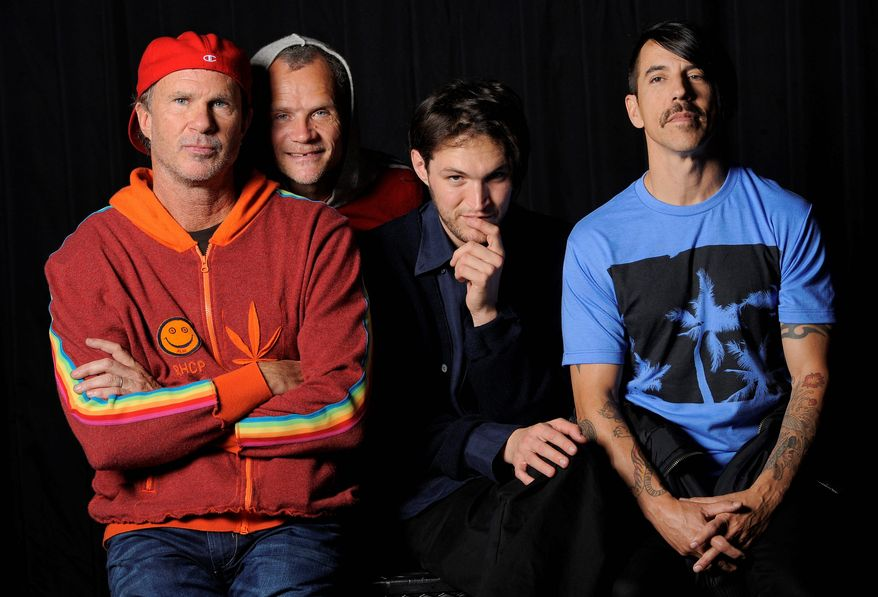The Red Hot Chili Peppers (from left) drummer Chad Smith, bassist Flea, guitarist Josh Klinghoffer and singer Anthony Kiedis will play at this year's Lollapalooza music festival in Chicago. (Associated Press)
