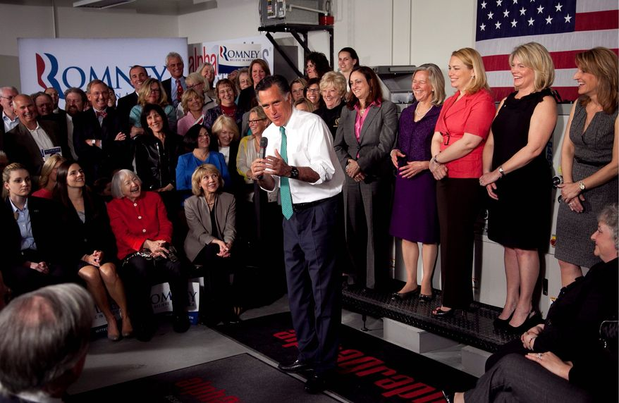 """Mitt Romney argues in Hartford, Conn., on Wednesday that he is the better candidate for women. """"The real war on women is being waged by the president's failed economic policies,"""" he said. President Obama won 56 percent of the female vote in 2008. (Associated Press)"""
