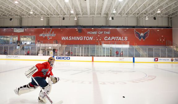 Washington Capitals goalie Braden Holtby (70) warms up for a morning practice at Kettler Capitals Iceplex, Arlington, Va., Tuesday, April 10, 2012. (Andrew Harnik/The Washington Times)