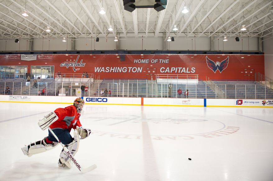 Washington Capitals goalie Braden Holtby (70) warms up for a morning practice at Kettler Capitals Iceplex, Arlington, Va., Tuesday, April 10, 2012. (Andrew Harnik/The Washington Times)