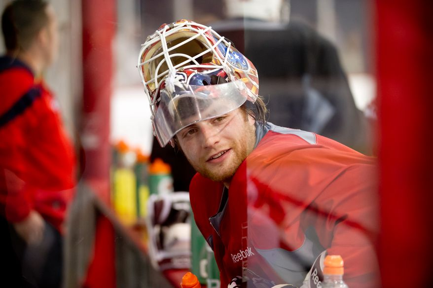 Washington Capitals goalie Braden Holtby (70) takes a break during morning practice at Kettler Capitals Iceplex, Arlington, Va., Tuesday, April 10, 2012. (Andrew Harnik/The Washington Times)