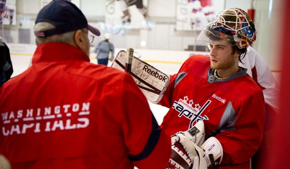 Washington Capitals goalie Braden Holtby (70), right, takes a break during morning practice at Kettler Capitals Iceplex, Arlington, Va., Tuesday, April 10, 2012. (Andrew Harnik/The Washington Times)