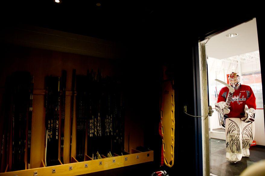 Washington Capitals goalie Braden Holtby (70) heads back to the locker room following morning practice at Kettler Capitals Iceplex, Arlington, Va., Tuesday, April 10, 2012. (Andrew Harnik/The Washington Times)