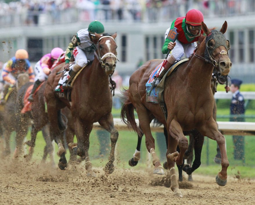 ** FILE ** In this Saturday, May 7, 2011, file photo, John Velazquez rides Animal Kingdom to victory during the 137th Kentucky Derby horse race at Churchill Downs in Louisville, Ky. (AP Photo/Michael Conroy)