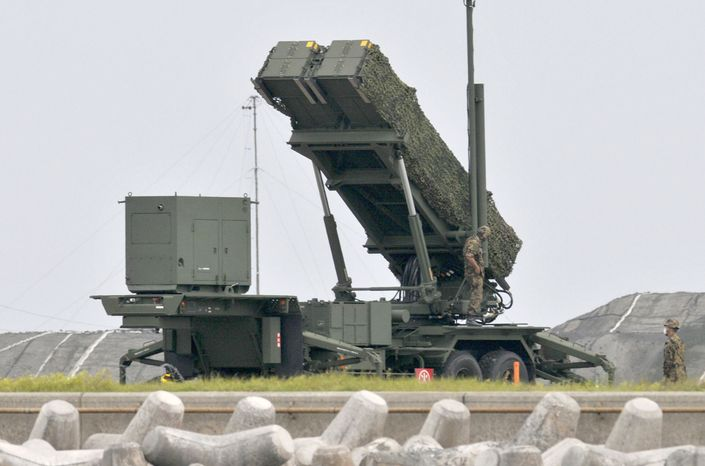 Japan Self-Defense Force members work April 11, 2011, on a unit of Japan Air Self-Defense Force's PAC-3 surface to air missile deployed in Ishigaki, Japan's southern most prefecture of Okinawa. Japan is on alert for North Korea's rocket which is expected to launch between April 12-16. (Associated Press/Kyodo News)
