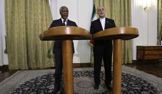 Former U.N. Secretary-General Kofi Annan (left), the U.N.-Arab League special envoy to Syria, speaks during a joint press conference with Iranian Foreign Minister Ali Akbar Salehi in Tehran on Wednesday, April 11, 2012. Mr. Annan appealed to Iran, Syria's ally, to support his plan to end the violence wracking that Arab country. (AP Photo/Vahid Salemi)