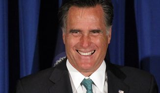 Republican presidential candidate and former Massachusetts Gov. Mitt Romney smiles as he is introduced April 10, 2012, by Sen. Pat Toomey, Pennsylvania Republican, at the spring reception for the Republican Committee of Chester County in Mendenhall, Pa. (Associated Press)