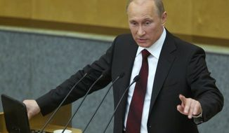 Russian Prime Minister Vladimir Putin speaks to the State Duma, the Russian parliament's lower house, in Moscow on Wednesday, April 11, 2012. (AP Photo/Ivan Sekretarev)