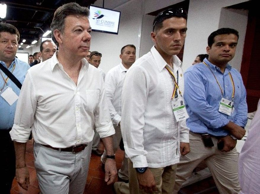 The diplomatic skills of Colombian President Juan Manuel Santos (left) were tested when the U.S. opposed Cuba's participation in this weekend's summit of Western Hemisphere leaders. (Associated Press)