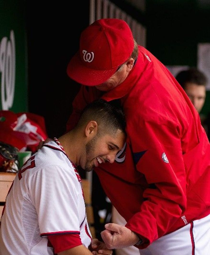 Nationals starter Gio Gonzalez gets a playful punch  from a coach after working seven shutout innings against Cincinnati. Gonzalez added to the Nationals' pitching dominance of late, as the starters haven't allowed a run in the last three games. (Andrew Harnik/The Washington TImes)
