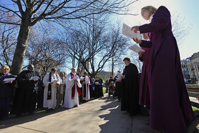 **FILE** Connecticut religious leaders who oppose the death penalty stop for a prayer during an April 3, 2012, march in Hartford, Conn., to the state Capitol for a rally in favor of repealing the punishment at state level. (Associated Press)