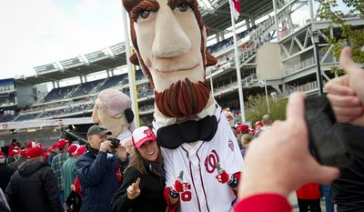 Nicole Desonia, of Centreville, Va., poses with Abe, of The Racing Presidents prior to game time. (Rod Lamkey Jr/The Washington Times)
