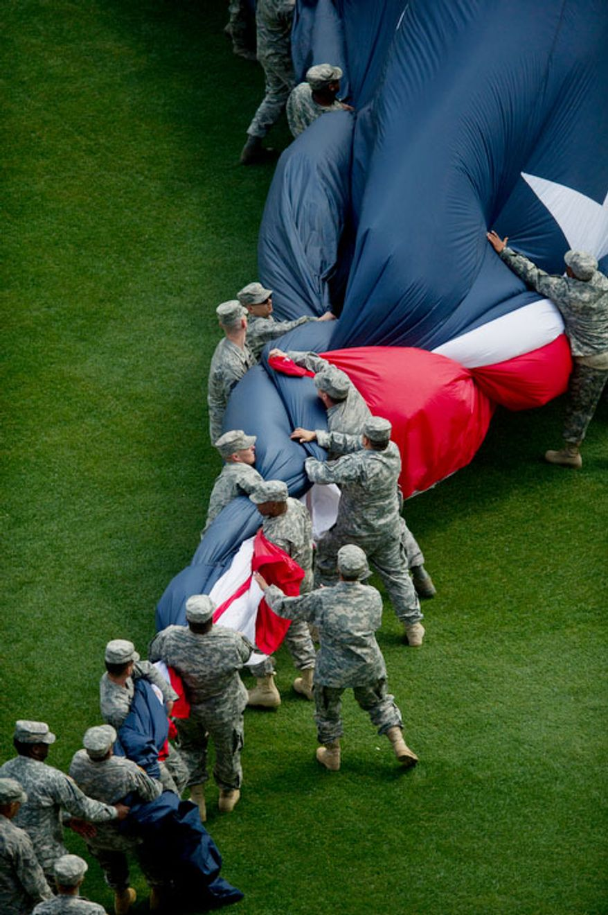 The American flag is rolled up in breeze in the outfield during the Nationals' home opener. (Rod Lamkey Jr/The Washington Times)