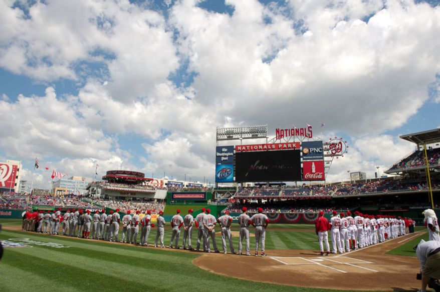 The Washington Nationals take and the Cincinnati Reds come out on the field before the start of the Nationals home opener. (Andrew Harnik/The Washington Times)