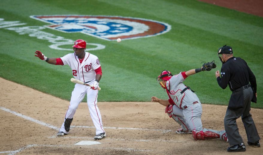 Washington Nationals center fielder Roger Bernadina (2) signals to third baseman Ryan Zimmerman, as catcher Devin Mesoraco (39) can't recover a wild pitch by Alfredo Simon in the bottom of the 10th inning. (Rod Lamkey Jr/The Washington Times)