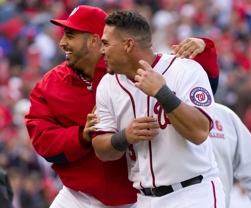 Washington Nationals starting pitcher Gio Gonzalez (47), left, and Washington Nationals catcher Wilson Ramos (3), right, celebrate together after Washington Nationals third baseman Ryan Zimmerman (11) steals home in the 10th inning on a wild pitch by Cincinnati Reds relief pitcher Alfredo Simon (31) to win the game in extra innings, 3-2. (Andrew Harnik/The Washington Times)
