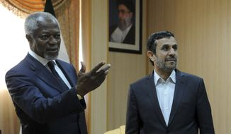 In this photo released by the semi-official Iranian Students News Agency (ISNA), International envoy Kofi Annan, left, gestures during his meeting with Iranian President Mahmoud Ahmadinejad, on the Iranian island of Qeshm, Wednesday, April 11, 2012. (AP Photo/ISNA, Hamid Foroutan)