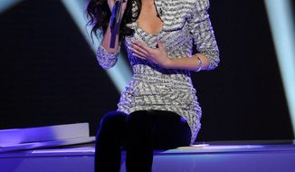 "In this April 11, 2012, photo released by Fox, Jessica Sanchez performs on the singing competition series ""American Idol,"" in Los Angeles. (AP Photo/Fox, Michael Becker)"