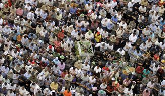 Islamist protesters perform Friday prayers in Tahrir Square during a April 13, 2012, rally to denounce the presidential candidacies of Hosni Mubarak-era officials, including that of his former spy chief in Cairo. (Associated Press)