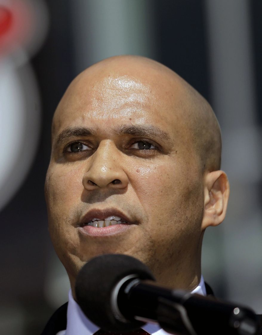 ** FILE ** Newark Mayor Cory Booker talks during a news conference outside of the Prudential Center, in this April 4, 2012, file photo taken in Newark. (AP Photo/Julio Cortez, File)