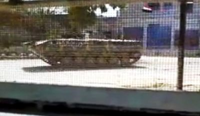 This image made from amateur video released by the Shaam News Network and accessed Thursday, April 12, 2012, purports to show a Syrian military armored vehicle in Idlib, Syria. The Associated Press cannot independently verify the content, date, location or authenticity of this material. (AP Photo/Shaam News Network via AP video)