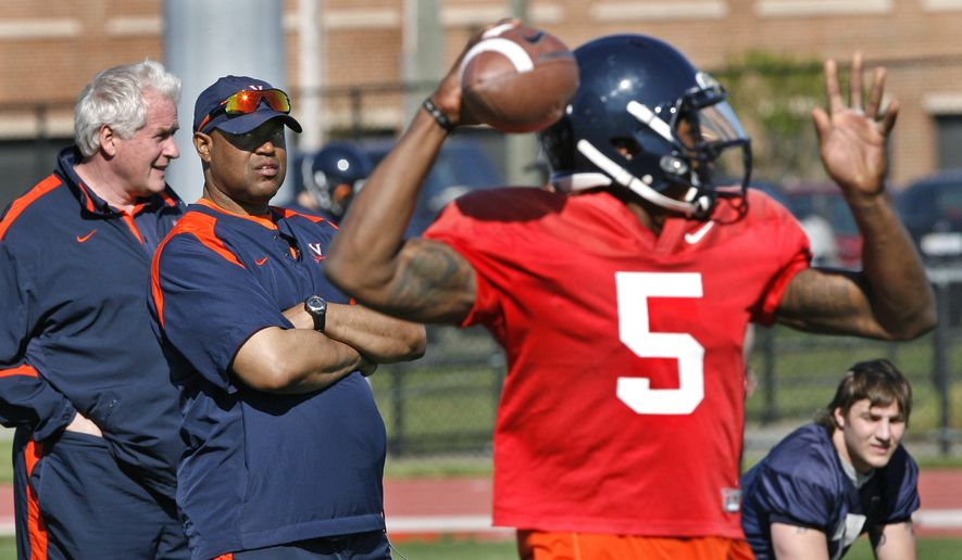 Virginia head coach Mike London, second from left, and assistant coach Bob Price watch quarterback David Watford during spring football practice at Sports Backers Stadium in Richmond, Va., on Saturday, April 7, 2012. On the right is quarterback Kyle McCartin. (AP Photo/Richmond Times-Dispatch, P. Kevin Morley)