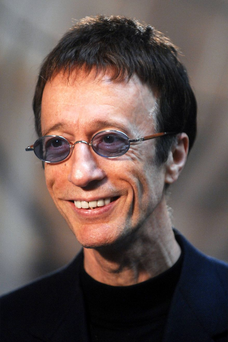 **FILE** Former Bee Gees singer Robin Gibb talks with journalists at the European Parliament in Brussels in April 2007. (Associated Press