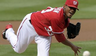 Washington Nationals starting pitcher Edwin Jackson delivers to the Cincinnati Reds during their game in Washington on Saturday, April 14, 2012. (AP Photo/Susan Walsh)
