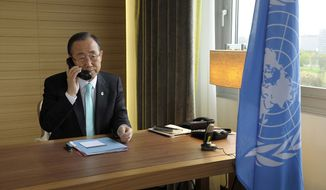 In this photo provided by the United Nations, United Nations Secretary-General Ban Ki-moon speaks via telephone to with U.N.-Arab League envoy Kofi Annan from his hotel room in Geneva, Switzerland, on Thursday, April 12, 2012, the deadline for the cease-fire in Syria. (AP Photo/The United Nations, Evan Schneider)