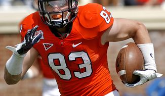 "Virginia ""Orange Team"" Jake McGee (83) runs for yardage after a reception during Virginia's spring football game at Scott Stadium in Charlottesville, Va., on Saturday, April 14, 2012. (AP Photo/Richmond Times-Dispatch, Mark Gormus)"
