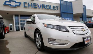 Gas prices flying past $4 a gallon have played a big part in a surge in sales of hybrid and electric cars, including the Chevrolet Volt. In March, General Motors Co. set a monthly sales record of 2,289 for the Volt, an electric car with a small backup gas engine. It sold just 7,671 Volts last year. (Associated Press)