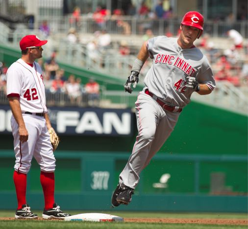 Cincinnati's Ryan Ludwick rounds the bases after hitting a grand slam off Ross Detwiler during the first inning. Tyler Clippard had his problems in the 11th, allowing three runs in the Nationals' 8-5 loss. (Associated Press)