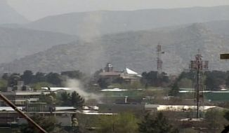 Smoke rises following attacks on Sunday, April 15, 2012, by Taliban militants on three neighborhoods of Kabul, Afghanistan, that are home to government buildings, Western embassies and NATO facilities. (AP Photo/AP Video)