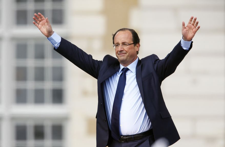 Francois Hollande, the Socialist Party's candidate for French president, gestures to supporters following his speech at a campaign rally in Vincennes, France, outside Paris, on Sunday, April 15, 2012. (AP Photo/Francois Mori)