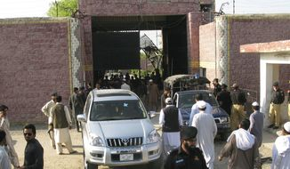 "Pakistani security officials visit the central prison in Bannu, 106 miles south of Peshawar, Pakistan, on Sunday, April 15, 2012, after Taliban militants battled their way into the prison and freed close to 400 prisoners, including at least 20 described by police as ""very dangerous"" insurgents, authorities and the militants said. (AP Photo/Ijaz Muhammad)"