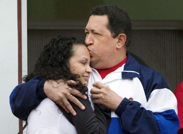 "Mr. Chavez kisses the forehead of his daughter, Rosa Virginia, at the presidential palace in Caracas. The socialist president said that he has faith in a ""miracle,"" as he undergoes radiation therapy in Cuba following two surgeries to remove pelvic tumors."