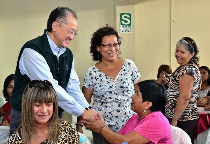 ASSOCIATED PRESS Jim Yong Kim greets an unidentified woman at a cultural center in Lima, Peru, on Sunday during a global tour that has taken him to Africa, Asia and Latin America to seek support from developing countries. He begins a five-year term as head of the World Bank in July. He was nominated by President Obama.
