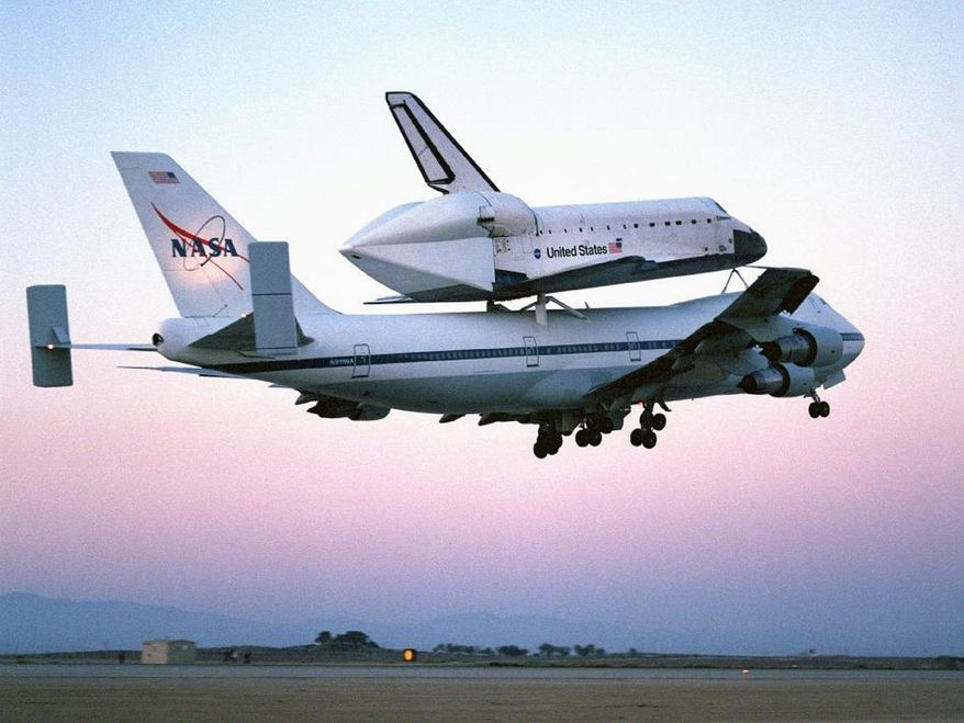 The space shuttle Discovery flies piggyback atop a modified Boeing 747 in an undated photo. It will take a similar ride, its last, along the Potomac on Tuesday morning on its way to the Smithsonian's Steven F. Udvar-Hazy Center near Washington Dulles International Airport. (Photograph provided by NASA)