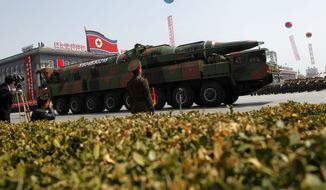 ** FILE ** A military vehicle carries what appeared to be a new missile during a mass military parade through Kim Il-sung Square in Pyongyang, North Korea, on Sunday, April 15, 2012, to celebrate the centenary of the birth of North Korean founder Kim Il-sung. (AP Photo/Ng Han Guan)
