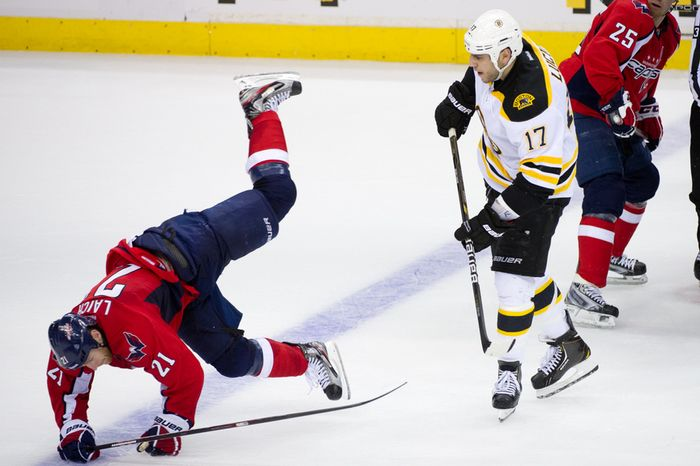 Washington Capitals center Brooks Laich (21) and Boston Bruins left wing Milan Lucic (17) are called for unsportsmanlike conduct before a face off in the second period as the Washington Capitals take on the Boston Bruins in game three of National Hockey League first round playoff hockey at the Verizon Center, Washington, D.C., Monday, April 16, 2012. (Andrew Harnik/The Washington Times)