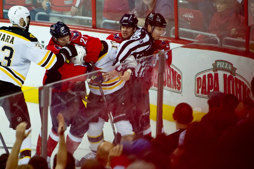 Washington Capitals defenseman Karl Alzner (27), second from left, Boston Bruins left wing Milan Lucic (17), third from left, and Washington Capitals left wing Matt Hendricks (26), second from right, have to be separated during a scuffle in the third period as the Washington Capitals lose to the Boston Bruins in game three, 3-4, of National Hockey League first round playoff hockey at the Verizon Center, Washington, D.C., Monday, April 16, 2012. (Andrew Harnik/The Washington Times)