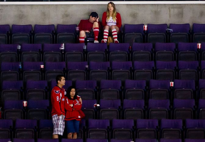Dejected fans linger in the stands after the Washington Capitals lose to the Boston Bruins in game three, 3-4, of National Hockey League first round playoff hockey at the Verizon Center, Washington, D.C., Monday, April 16, 2012. (Andrew Harnik/The Washington Times)