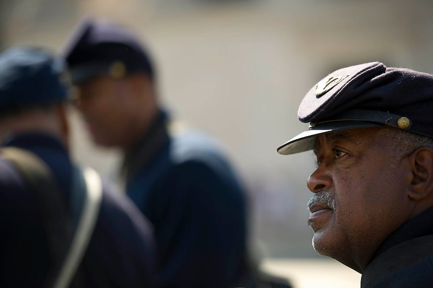 Robert Wright portrays a member of the 54th Massachusetts Volunteer Infantry as he and others waits to march in the District of Columbia Emancipation Day 2012 parade in Washington, D.C., Monday, April 16, 2012., celebrating the150th anniversary of the District of Columbia Emancipation Act. 150 ears ago, on April 16, 1862, President Abraham Lincoln signed a bill ending slavery in the District of Columbia. Passage of this law came 8 1/2 months before President Lincoln signed his Emancipation Proclamation. (Rod Lamkey Jr/The Washington Times)