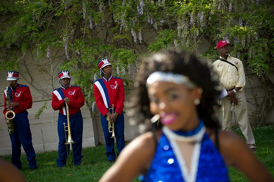 Members of the Anacostia High School band practice in the shade as they wait to march in the District of Columbia Emancipation Day 2012 parade in Washington, D.C., Monday, April 16, 2012., celebrating the150th anniversary of the District of Columbia Emancipation Act. 150 ears ago, on April 16, 1862, President Abraham Lincoln signed a bill ending slavery in the District of Columbia. Passage of this law came 8 1/2 months before President Lincoln signed his Emancipation Proclamation. (Rod Lamkey Jr/The Washington Times)