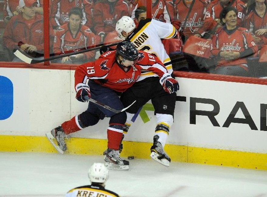 Capitals center Nicklas Backstrom (19), taking Bruins defenseman Greg Zanon into the boards in Game 3, drew a match penalty for a cross-check on center Rich Peverley. The NHL is expected to issue a ruling on the play Wednesday. (Associated Press)