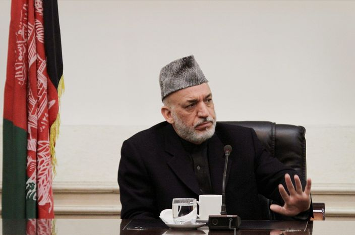 Afghan President Hamid Karzai has signed laws that protect women's rights but also has made comments that have alarmed defenders of those rights. He ignited a firestorm last year when he attempted to bring all women's shelters under government control. (Associated Press)