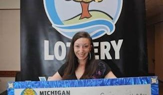 Amanda Clayton won a $1 million lottery jackpot but continued to collect food stamps and public health insurance, leading to state welfare fraud charges. (Michigan Lottery via Detroit Free Press)
