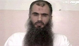 ** FILE ** Radical cleric Abu Qatada is pictured in the Belmarsh high-security prison in London on a video from 2005. (AP Photo/Her Majesty's Prison Service)