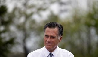 Republican presidential candidate Mitt Romney listens on Tuesday, April 17, 2012, during a meeting with a group of Pittsburgh-area residents in Bethel Park, Pa. (Associated Press)