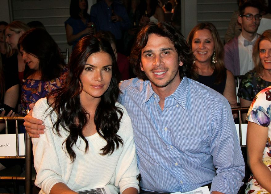 "Ben Flajnik, star of the ABC romance series ""The Bachelor,"" and his fiancee Courtney Robinson are in ""no rush"" to set a wedding date. (Associated Press)"
